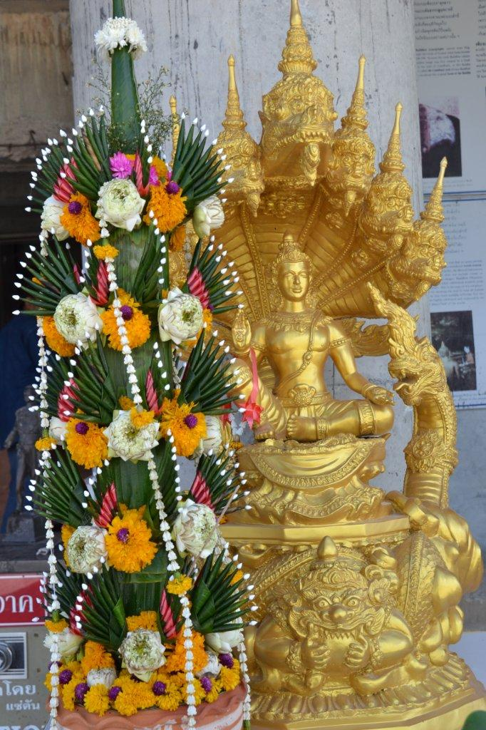 Golden Buddha and Flowers